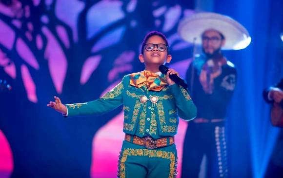 Why in Colombia do children sing so many rancheras?