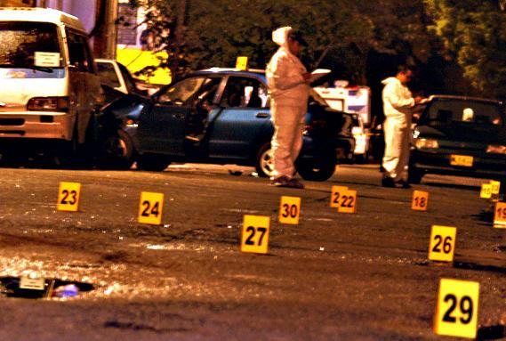 La escena del crimen en el barrio Santa Lucía, en la cual los criminalistas recogieron 27 vainillas. Foto de Tavo.