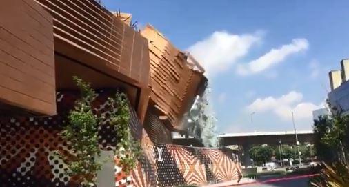 Captura de pantalla del momento en el que caea al suelo la facha del edificio. FOTO Captura de pantalla