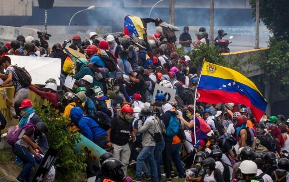 La calle ha sido uno de los escenarios de mayor poder de la oposición venezolana para exigir el fin del chavismo en el poder. Archivo EFE