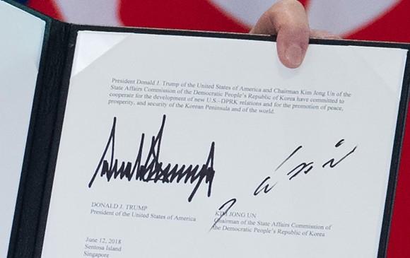 Documento firmado por Donald Trump y Kim Jong-un. FOTO AFP