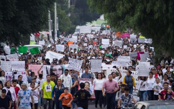 Cientos de personas salieron a las calles del municipio de Ecatepec, en el Estado de México, a reclamar justicia y en defensa de la mujer. EFE.