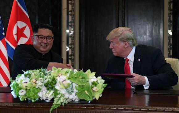 Kim Jong-un y Donald Trump. AFP