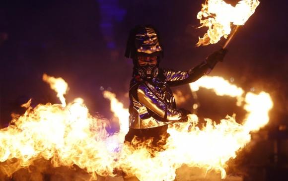 El fuego, símbolo importante de la cultura coreana, presente en la inauguración. Fotos Fedepatín y Reuters