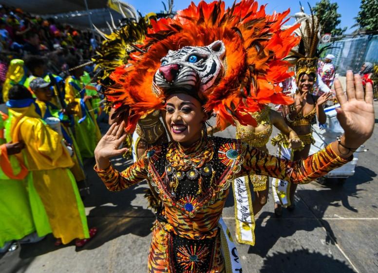 """Por su variedad y riqueza cultural, el Carnaval de Barranquilla fue reconocido en 2003 por la Unesco como """"Obra Maestra del Patrimonio Oral e Intangible de la Humanidad"""". FOTO AFP"""