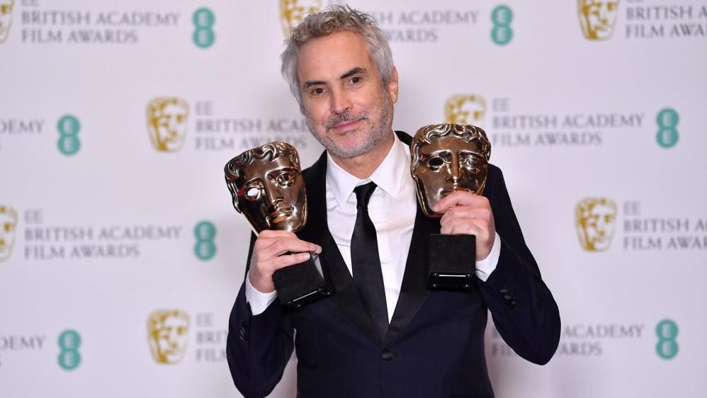 Alfonso Cuarón se llevó el premio como Mejor director y también Roma ganó como Mejor película. FOTO AFP